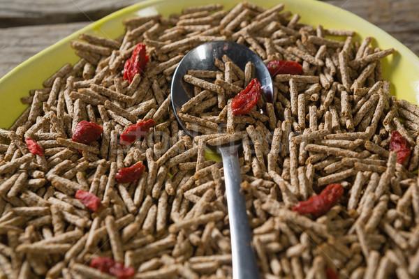 Cereal bran sticks with spoon in plate Stock photo © wavebreak_media