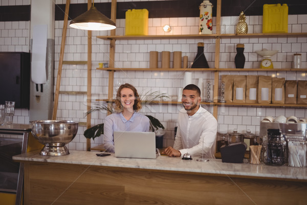 Portrait of smiling waitress and male owner using laptop at counter Stock photo © wavebreak_media
