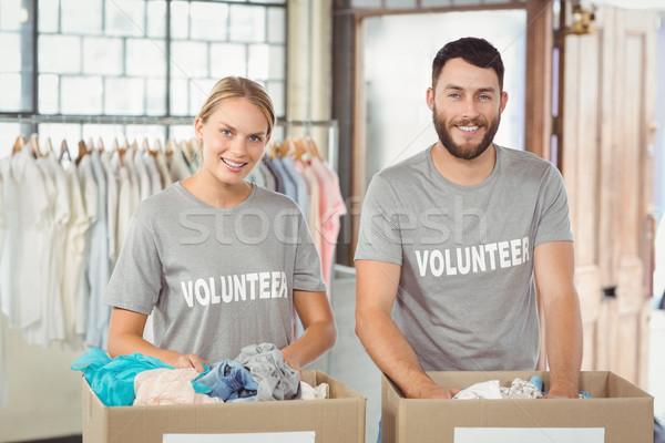 Portret glimlachend vrijwilligers donaties kleding kantoor Stockfoto © wavebreak_media