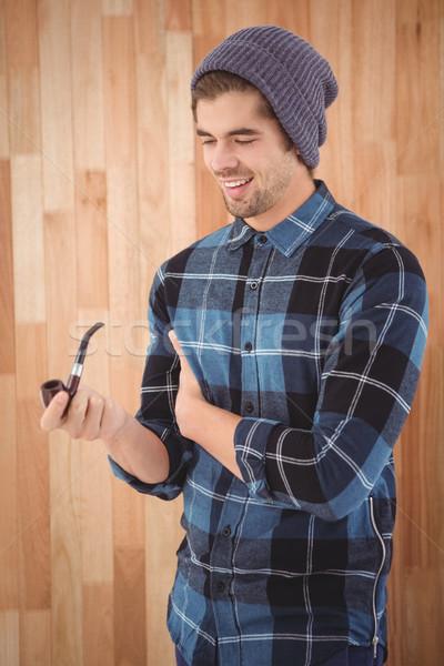 Boldog hipszter tart dohányzás cső áll Stock fotó © wavebreak_media