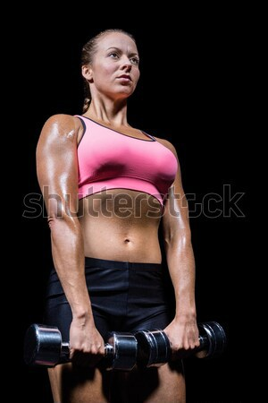 Cheerful athlete with hands on hip Stock photo © wavebreak_media