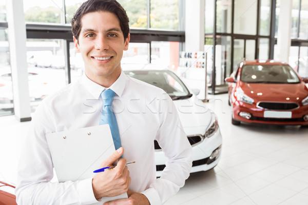 улыбаясь бизнесмен буфер обмена Новый автомобиль выставочный зал Сток-фото © wavebreak_media