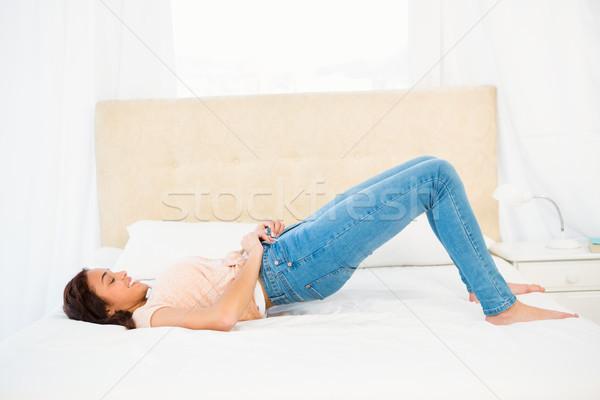 Casual sorrindo fechar jeans casa beleza Foto stock © wavebreak_media