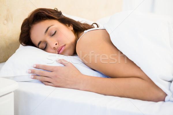 сонный женщину кровать домой женщины спальня Сток-фото © wavebreak_media