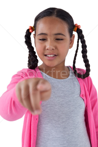 Girl pretending to touch an invisible screen Stock photo © wavebreak_media