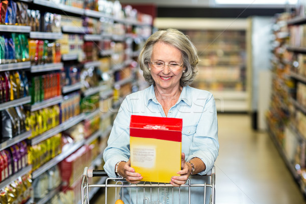 Smiling senior woman buying cereals Stock photo © wavebreak_media