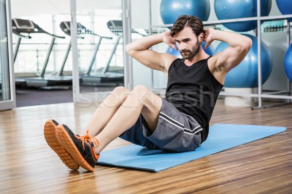 Ernstig man abdominaal lichaam fitness gezondheid Stockfoto © wavebreak_media