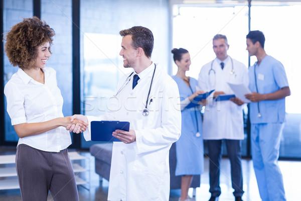 врач рукопожатием коллега больницу женщину счастливым Сток-фото © wavebreak_media
