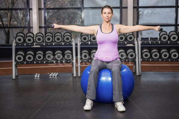 Determinado mulher halteres fitness bola Foto stock © wavebreak_media