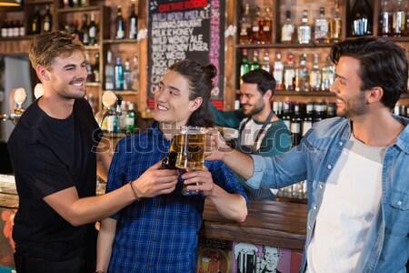 Happy friends having drinks in bar Stock photo © wavebreak_media
