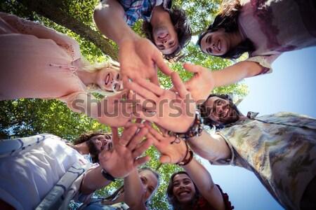 Portrait of fit friends forming huddle Stock photo © wavebreak_media