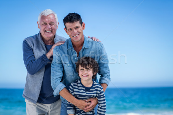 Male family members posing at the beach Stock photo © wavebreak_media