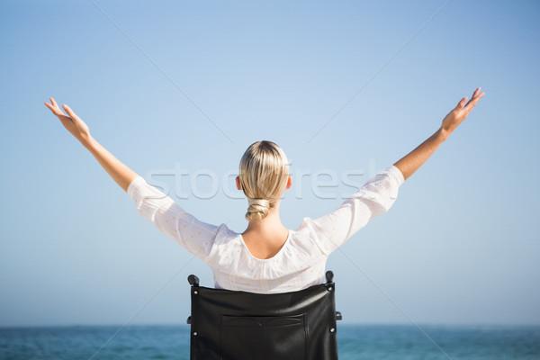 Woman in a wheelchair relaxing Stock photo © wavebreak_media