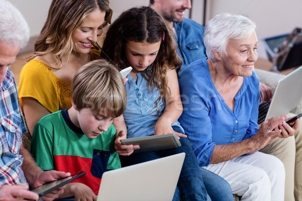 Multi-generation family using a laptop, tablet and phone Stock photo © wavebreak_media