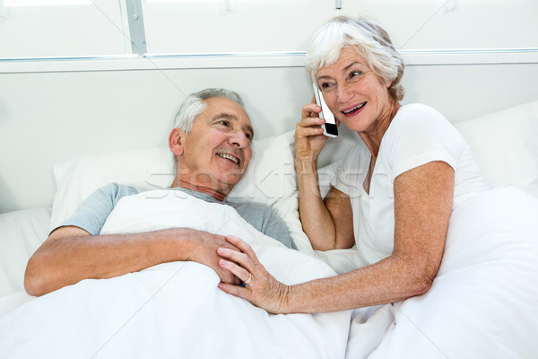 High angle view of senior woman with man talking on phone Stock photo © wavebreak_media