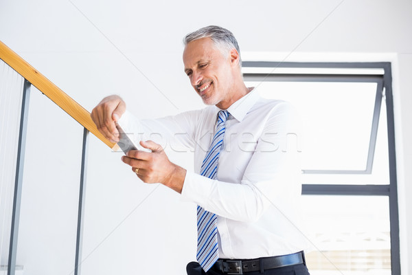 Businessman text messaging on mobile phone Stock photo © wavebreak_media