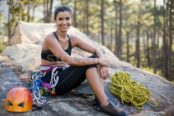 Woman smiling and sitting with climbing equipment  Stock photo © wavebreak_media
