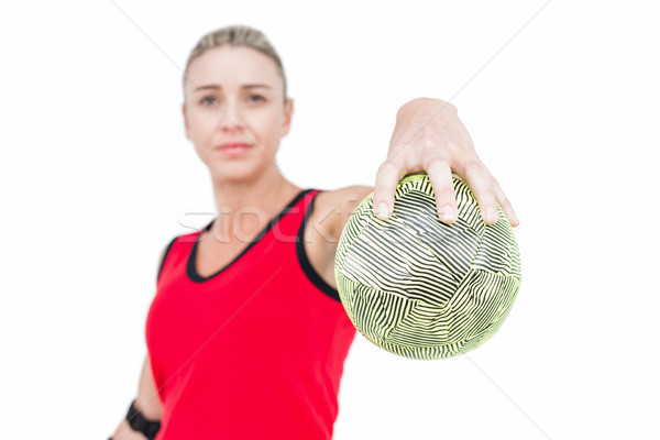 Female athlete with elbow pad holding handball Stock photo © wavebreak_media