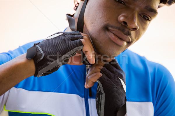 Athlete putting on cycling helmet Stock photo © wavebreak_media