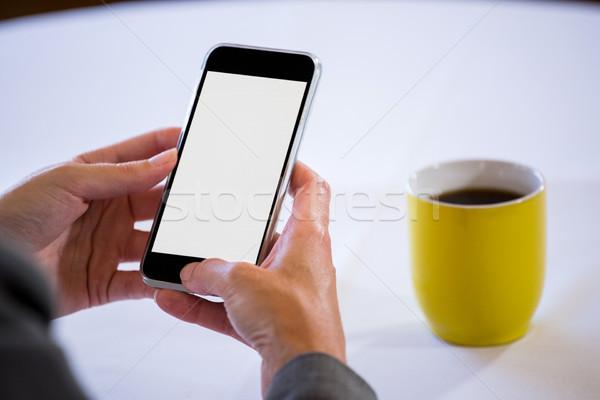 Woman taking a picture of coffee Stock photo © wavebreak_media