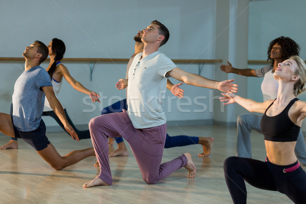 Group of people performing stretching exercise Stock photo © wavebreak_media