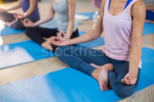 Group of women performing yoga Stock photo © wavebreak_media