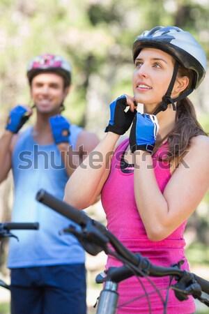 Female cyclist repairing her bicycle in park Stock photo © wavebreak_media