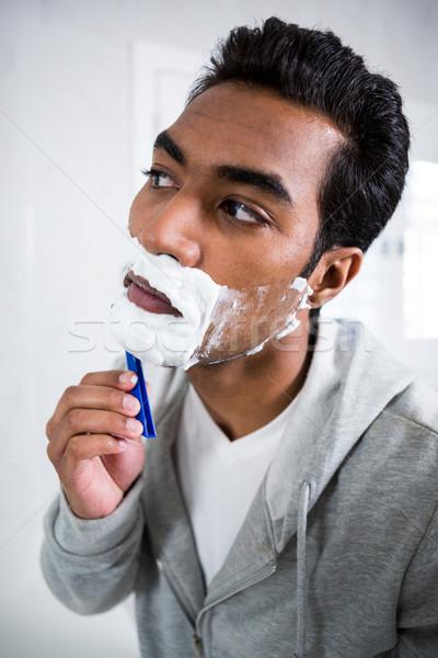 Férfi fürdőszoba otthon tükör férfi gyönyörű Stock fotó © wavebreak_media