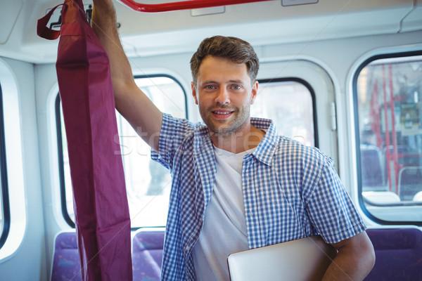 Jóképű férfi tart laptop utazás vonat portré Stock fotó © wavebreak_media