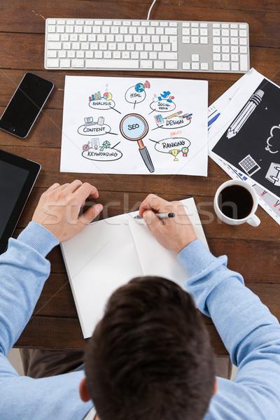 Man taking notes in diary Stock photo © wavebreak_media