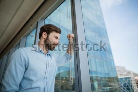 Retrato triste médico sessão escada hospital Foto stock © wavebreak_media