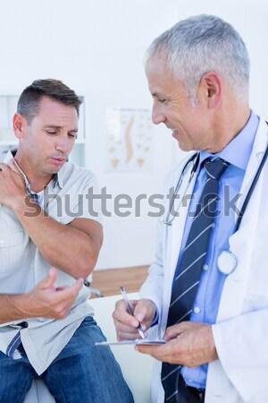 Doctor and patient discussing over digital tablet Stock photo © wavebreak_media