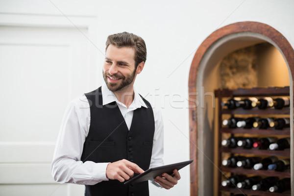 Male waiter smiling while using digital tablet Stock photo © wavebreak_media