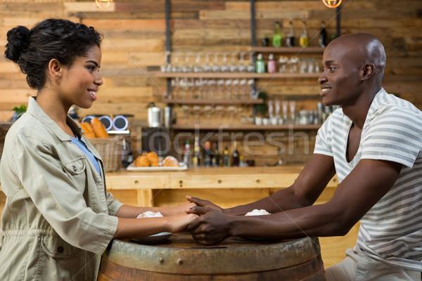 Szerető fiatal pér kéz a kézben asztal kávéház nő Stock fotó © wavebreak_media