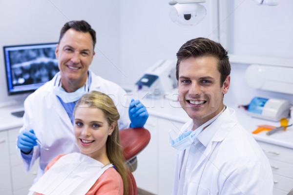 Portré mosolyog fogorvosok női beteg férfi Stock fotó © wavebreak_media