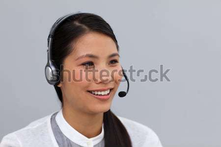 Charming young businesswoman with headset on Stock photo © wavebreak_media