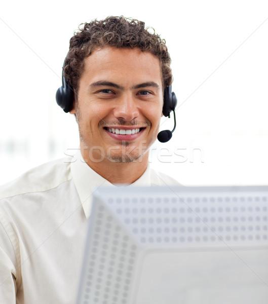 Latin young businessman with headset on  Stock photo © wavebreak_media