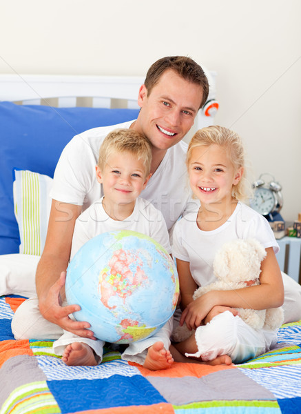 Cute children and their father looking at a terrestrial globe Stock photo © wavebreak_media