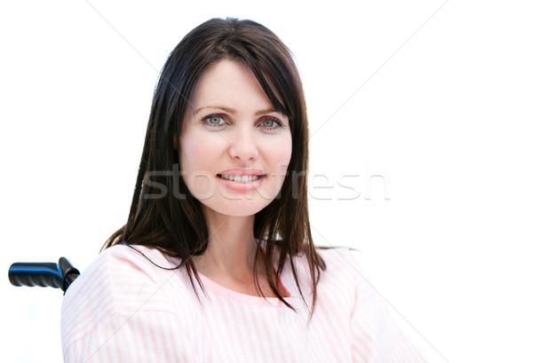 Beautiful female patient sitting in a wheelchair Stock photo © wavebreak_media