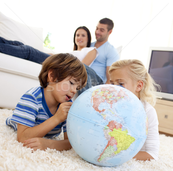 Children playing with a terrestrial globe in living-room Stock photo © wavebreak_media