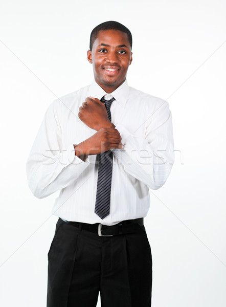Ethnic businessman corrects a cuff link Stock photo © wavebreak_media