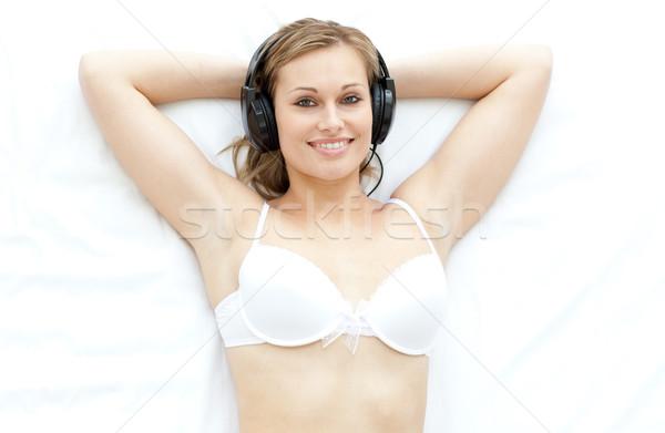 Attractive woman in underwear listening music  Stock photo © wavebreak_media