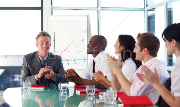 üzletemberek tapsol megbeszélés nemzetközi üzlet emberek üzlet Stock fotó © wavebreak_media