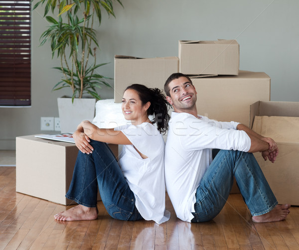 Joyful couple with unpacking boxes moving to a new house Stock photo © wavebreak_media