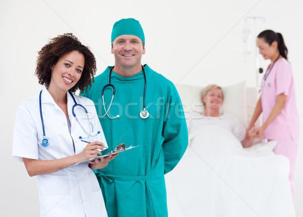 Stock fotó: Portré · néhány · orvosok · megvizsgál · beteg · kórház