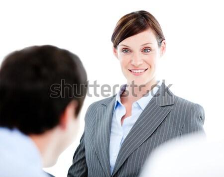 Portrait of a confident businesswoman talking at her colleague d Stock photo © wavebreak_media