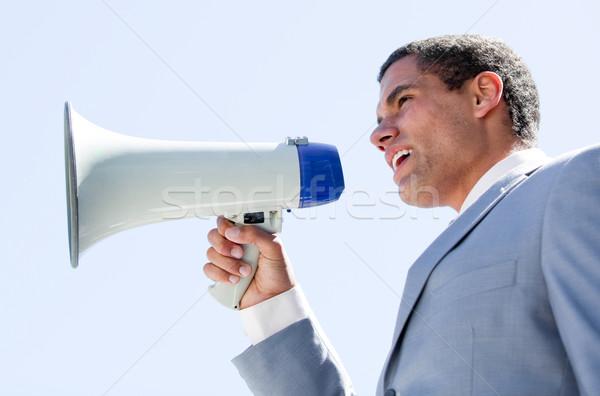 Charismatic businessman yelling through a megaphone  Stock photo © wavebreak_media