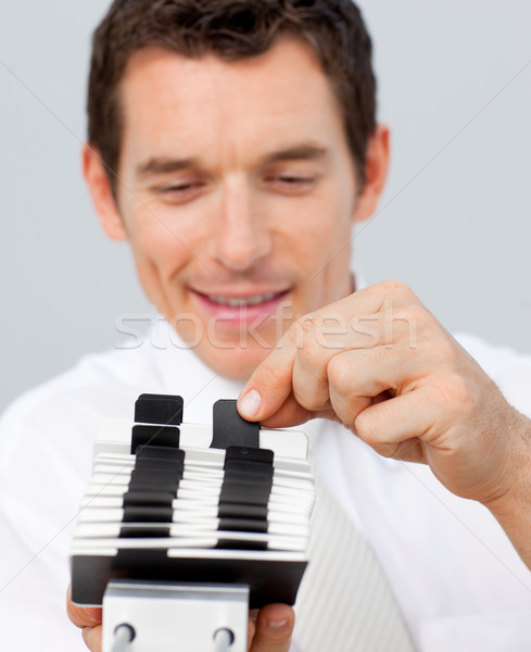 Close-up of a businessman consulting a card holder Stock photo © wavebreak_media