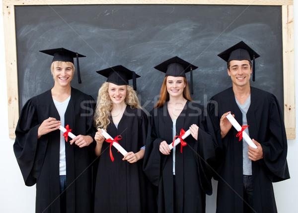 Groep vieren afstuderen gelukkig meisje gezicht Stockfoto © wavebreak_media