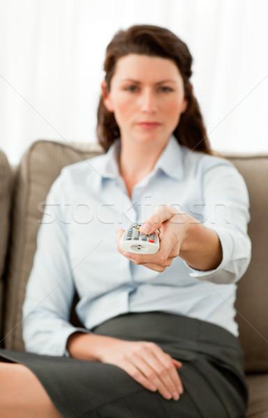Atrakcyjna kobieta zdalnego posiedzenia sofa domu Zdjęcia stock © wavebreak_media